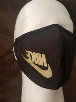 Nike Adult Face Mask, Black and Gold. New in Sealed Packagin